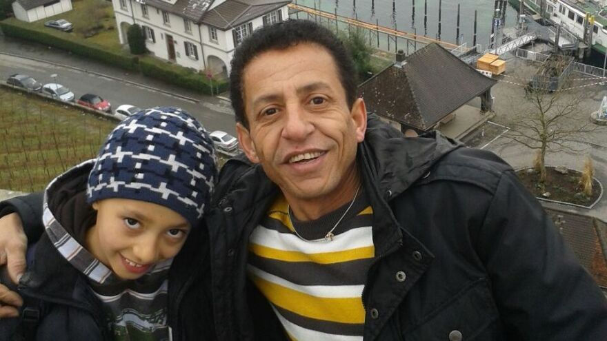 Emad al-Masaadi, 41, and his son Hamudeh, 9, from Damascus, Syria, now live in Friedrichshafen, Germany, where they are seeking asylum. Last year, the two traveled from Libya to Italy on a smuggler's boat that nearly sank with 400 people onboard.