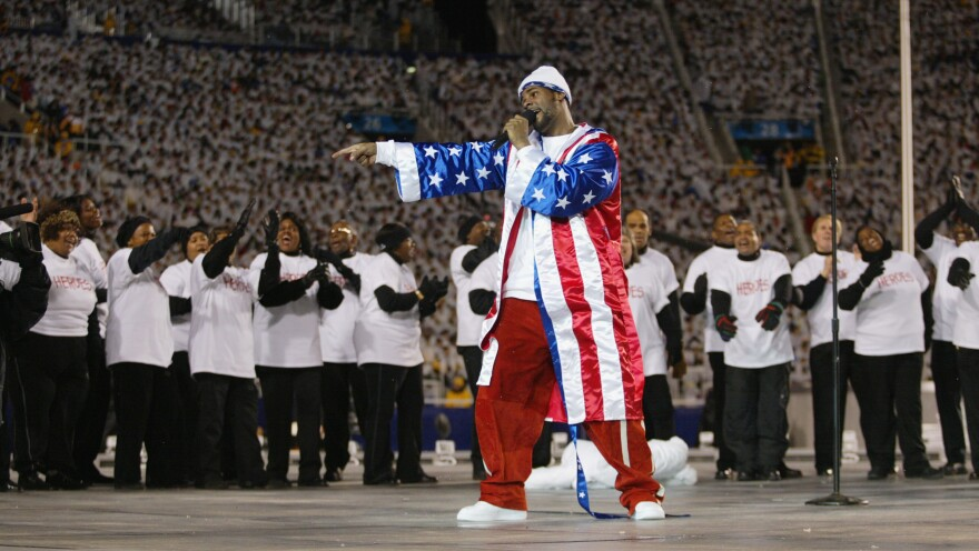 R. Kelly performs at the opening ceremony of the 2002 Winter Olympics in Salt Lake City, Utah. That very same day, Feb. 8, the Chicago police revealed their investigation into allegations that the singer had filmed himself having sexual relations with an underage girl.