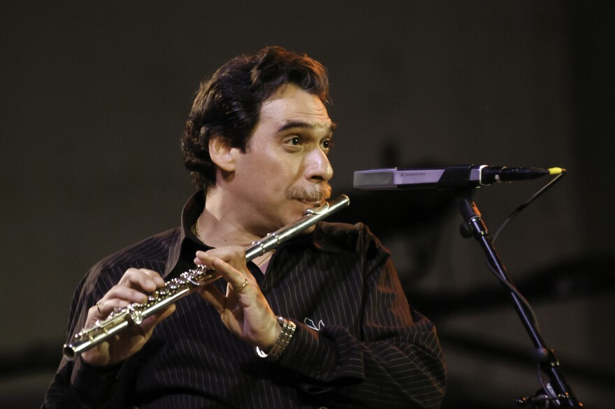 Jazz musician and flutist Dave Valentin performs with the McCoy Tyner Trio in New York City in 2003.