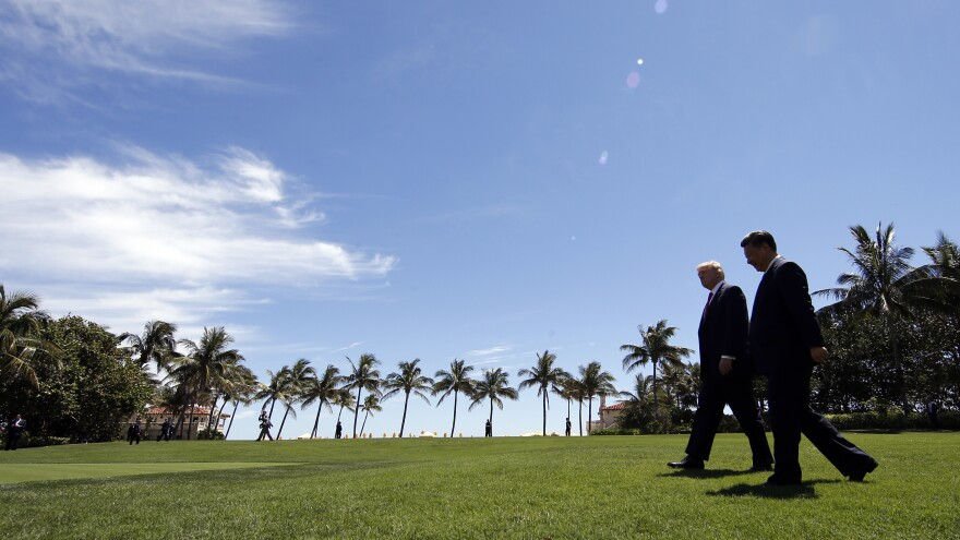 Trump and Chinese President Xi Jinping walk together after their meetings at Mar-a-Lago on April 7, 2017, in Palm Beach, Fla.