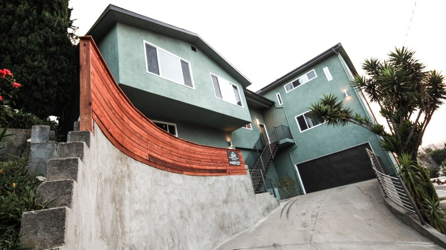 This home in the Glassell Park neighborhood of Los Angeles was bought by Dossier Capital for $390,000, records show. It's now listed for more than $720,000.