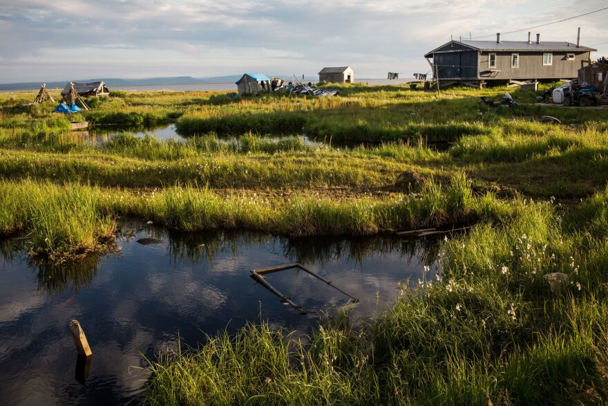 Rising temperatures in Alaska are melting permafrost, widening rivers and eroding homes in the remote village of Newtok, where about a third of residents relocated to higher ground last year.