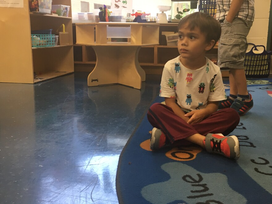 VPK student John Seng is sitting in his classroom, Monday.