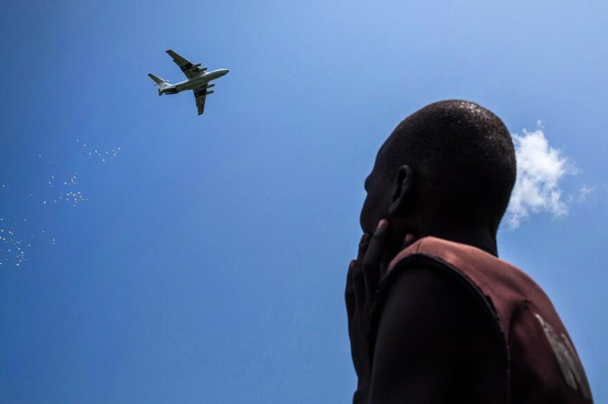 An International Red Cross plane drops emergency food supplies in Leer, South Sudan.