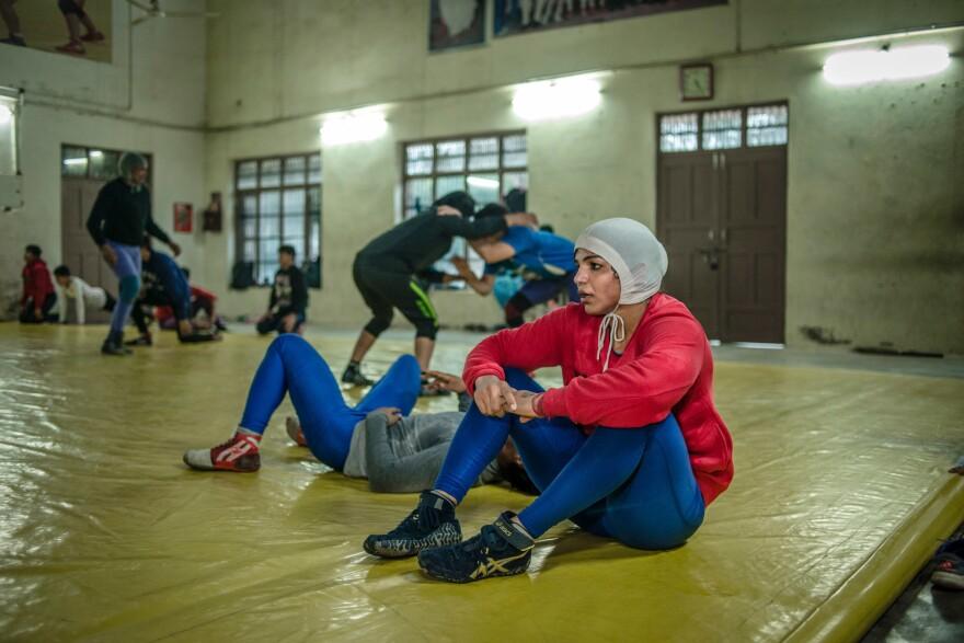 Sakshi Malik takes a break in the gym where she trains.