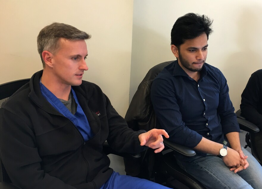 Dr. Matthew Lungren (left) and Pranav Rajpurkar attend a lab meeting where colleagues are testing an algorithm for tuberculosis diagnosis.