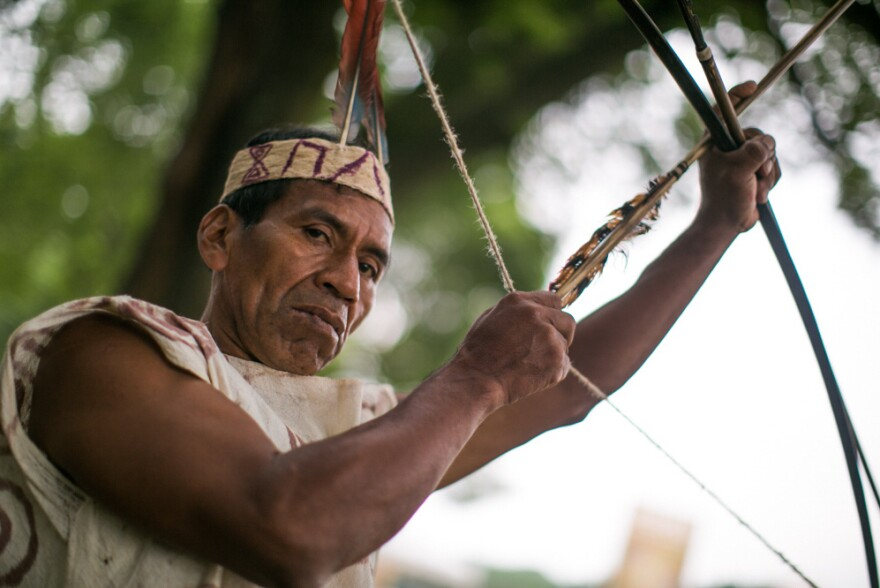 Victorio Dariquebe Gerewa displays his bow and arrow at the Smithsonian Folklife Festival in Washington, D.C.
