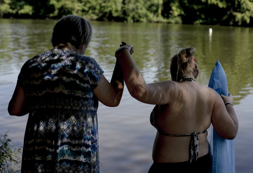 "Alicia Forbit and her sister-in-law Madison take a swim in the river after visiting her  Chris, Alicia's husband, in prison. ""We make memories that he will never be part of because we can't stop living and having fun while he is in prison."" Alicia said."