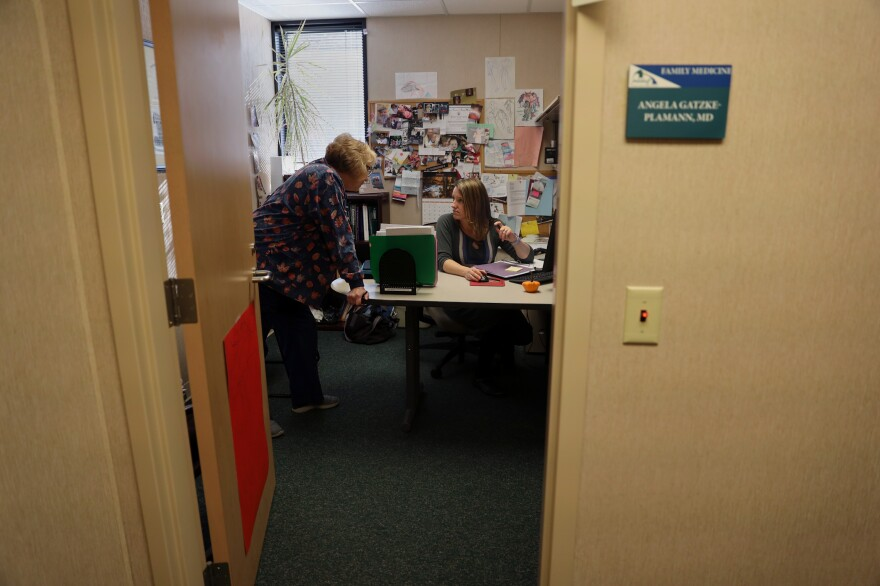 "Dr. Gatzke-Plamann in her office at the Necedah Family Medical Center with medical assistant Laurie Kenke. She says it's challenging to make room for a buprenorphine practice as well as a family practice, but she considers it an important responsibility for her community. ""There isn't another me just down the road. I'm the only one here. So if I can fulfill that need, then I should do that."""
