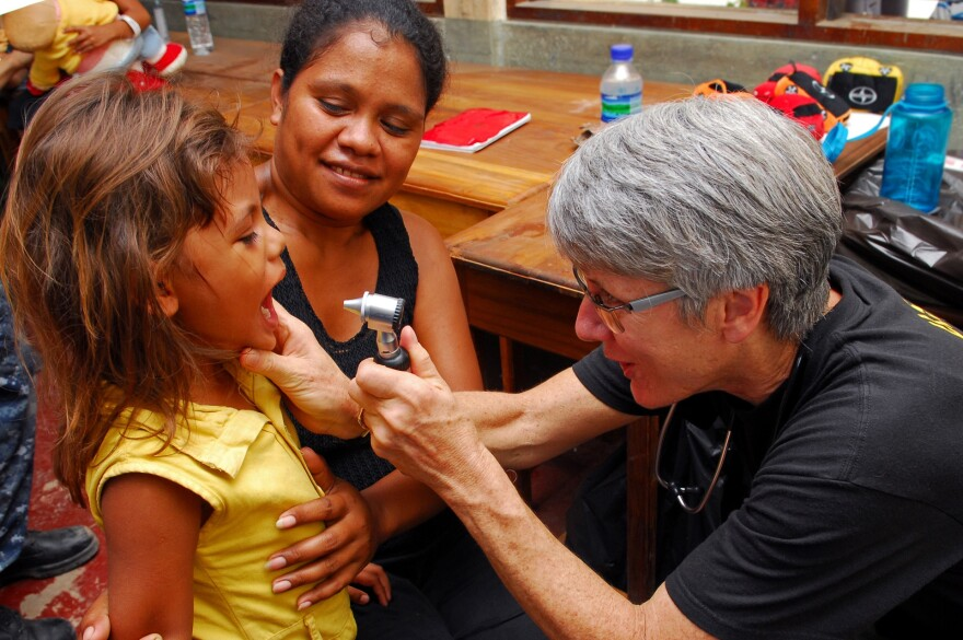 us_navy_100812-n-4044h-192_capt._susan_dunn__a_u.s._public_health_service_doctor__examines_a_child_during_a_medical_civic_action_program_event_in_dili__timor-leste.jpg