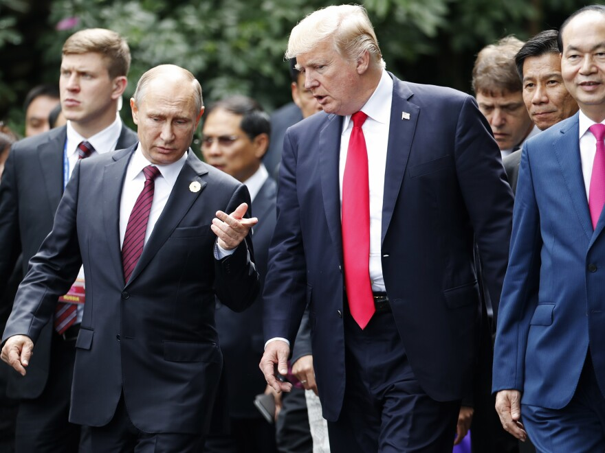"A day after meeting with the Russian president during an economic summit in Vietnam, President Trump told reporters he sided with U.S. intelligence agencies but believed that Putin ""feels"" his country ""did not meddle in the election."""