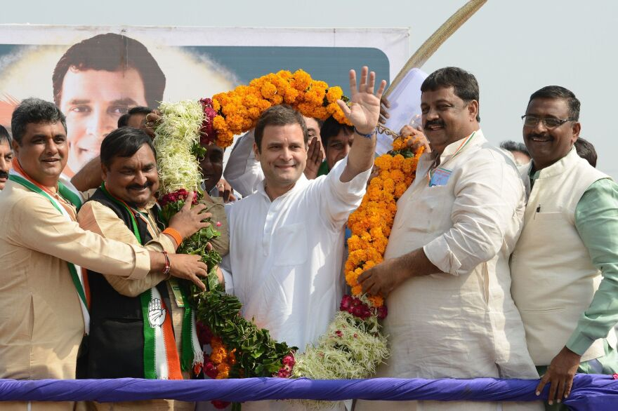 Rahul Gandhi (center), the new president of the Indian National Congress, waves while being garlanded during a political rally at Chilloda village on Nov. 11. Gandhi takes over the party leadership this week from his mother, Sonia Gandhi, who steps down after nearly two decades as the head of the party the Nehru-Gandhi family has dominated for 70 years.