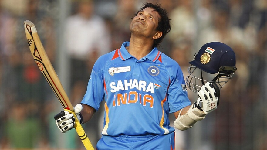 Sachin Tendulkar celebrates scoring his 100th century during the Asia Cup cricket match against Bangladesh in Dhaka on March 16, 2012. He said Thursday that he will retire from test cricket after his 200th test in November.