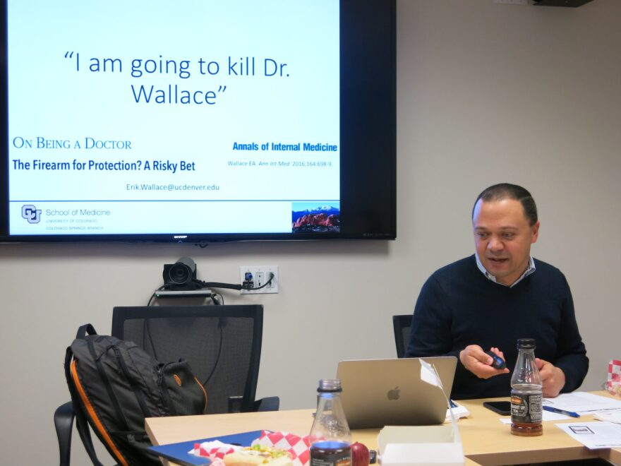 Dr. Erik Wallace tells his story during a 'Think Tank' meeting on how to reduce gun violence in El Paso County, Colo.