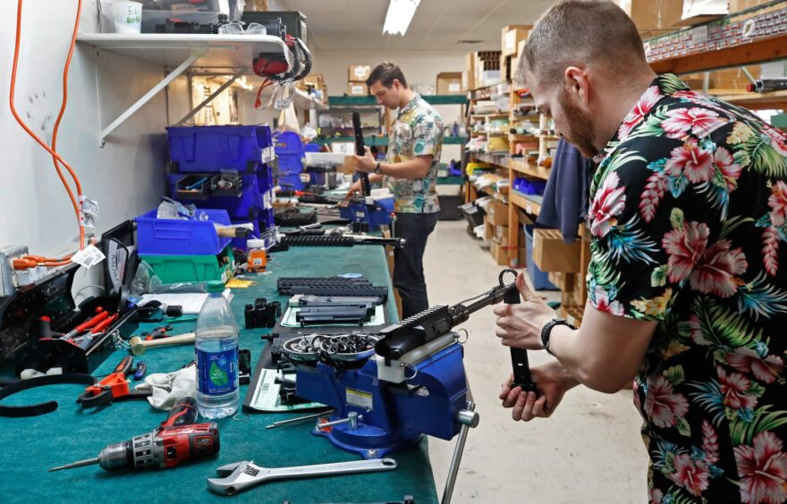 Workers assemble AR-15 rifles at Delta Team Tactical in Orem, Utah. Gun stores in the US are reporting a surge in sales of firearms as coronavirus fears trigger personal safety concerns.