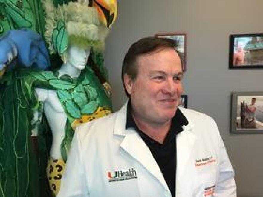 UM Zika vaccine developer David Watkins with one of his Brazilian carnival costumes.