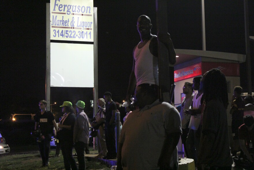 Charles Jones, 27, of St. Louis, watched the protest on West Florissant Ave. before gunfire erupted between two groups of people a block away.