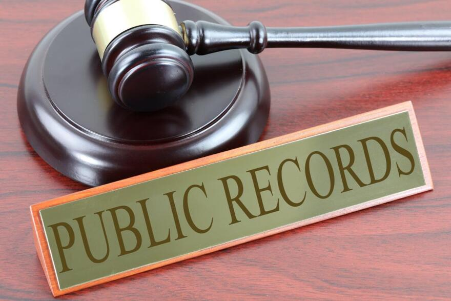 Gavel and sign saying Public Records