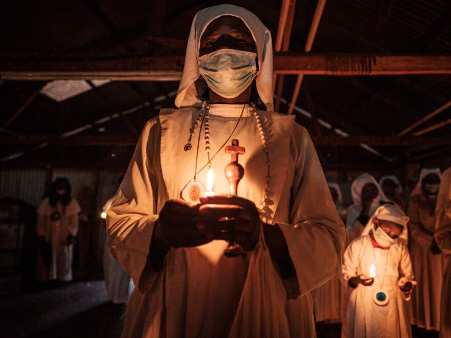 Worshippers of Legio Maria wearing face masks as a preventive measure against the spread of COVID-19 attend the Christmas service at their church in the Kibera slum of Nairobi, Kenya, on Dec. 25, 2020.