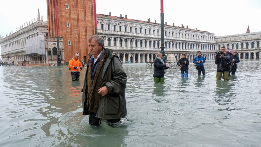 Venice Mayor Luigi Brugnaro trudges through high water in St. Mark's Square on Wednesday, the result of an exceptionally high tide in the scenic Italian city.