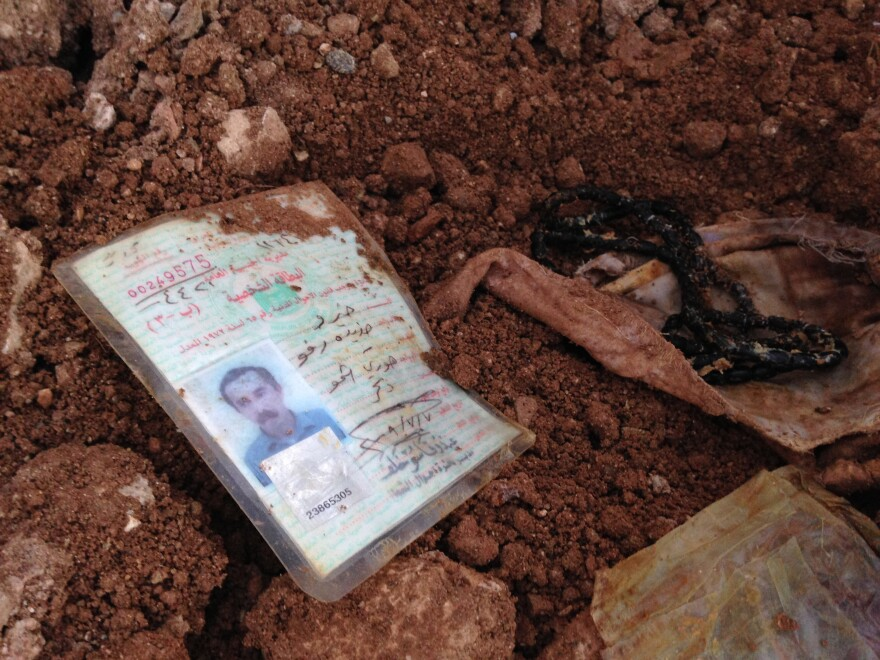 An identification card lies in the dirt in Hardan in December.