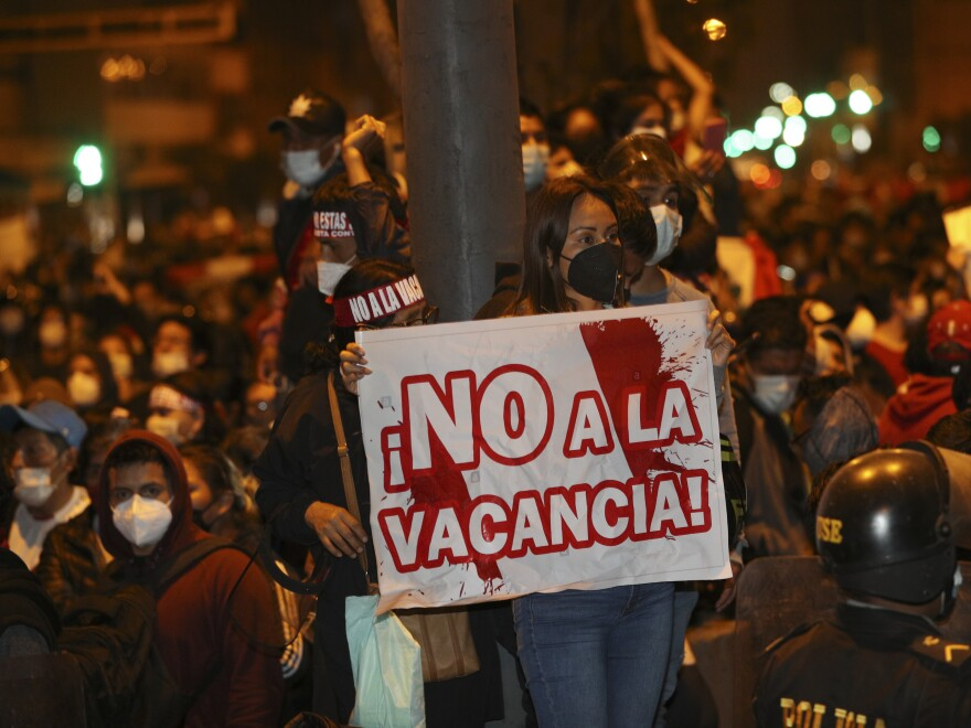 Supporters of President Martín Vizcarra protest the Peruvian Congress decision to oust him.