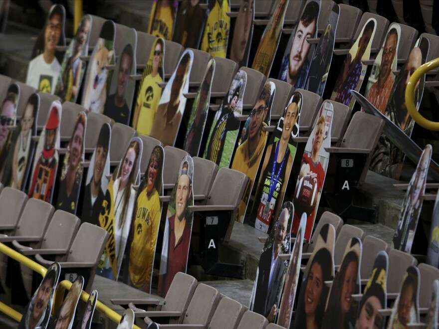 The NCAA says it hasn't decided on whether any fans will be allowed to watch the men's basketball tournament, which will center on Indianapolis. Here, cardboard placards populate Iowa's Carver-Hawkeye Arena.