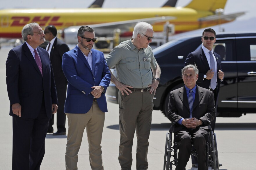 From left, El Paso Mayor Dee Margo, Sen. Ted Cruz, R-Texas, Sen. John Cornyn, R-Texas, and Texas Gov. Greg Abbott wait to greet President Donald Trump and first lady Melania Trump as they arrive in El Paso in August.