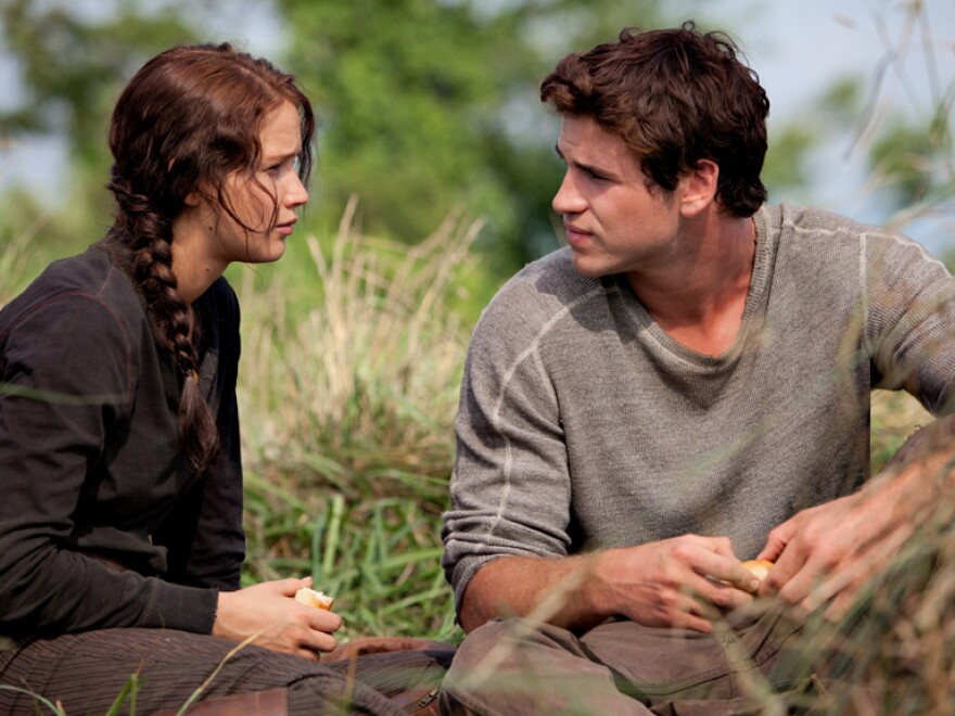In <em>The Hunger Games</em>, Katniss and Gale, played by Jennifer Lawrence and Liam Hemsworth in the movie adaptation, become friends while they are both struggling to feed their impoverished families.