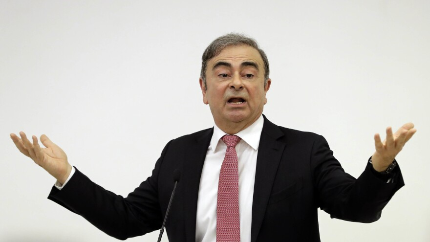 Former Nissan Chairman Carlos Ghosn addresses a news conference Wednesday in Beirut, during which he explained his reasons for dodging trial in Japan. The 65-year-old former auto executive, who is accused of financial misconduct, vowed to clear his name in his first public appearance since skipping bail in Japan.
