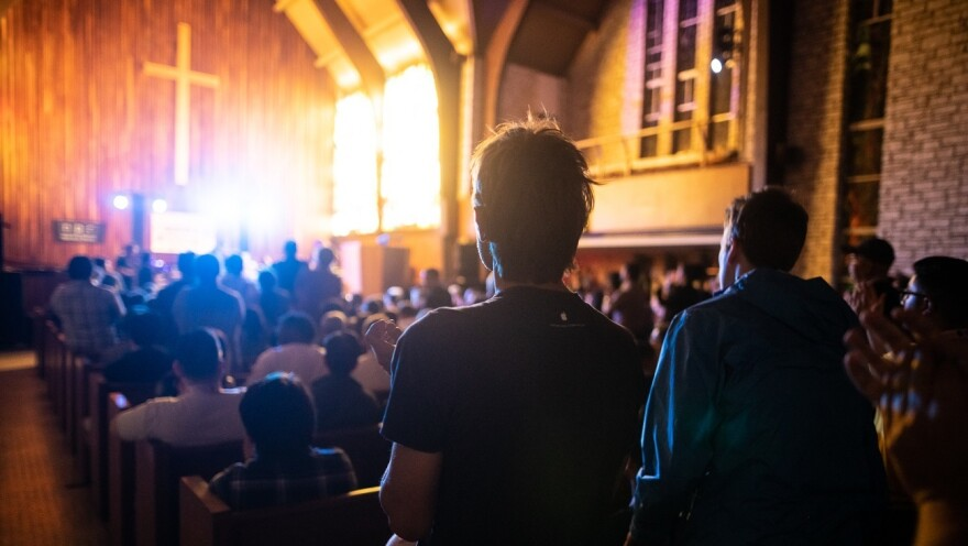 Onlookers watch Gaelynn Lea's performance at the Tiny Desk Family Hour at Central Presbyterian Church in Austin, TX, during the 2019 SXSW music festival.