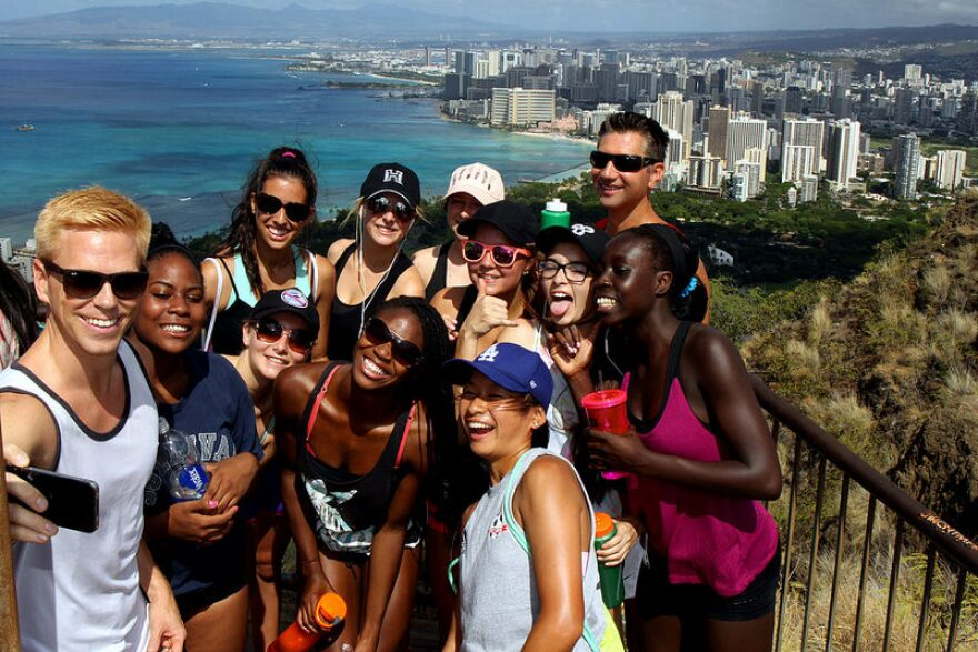 Group of young people posing for photo at Diamond Head, HI.