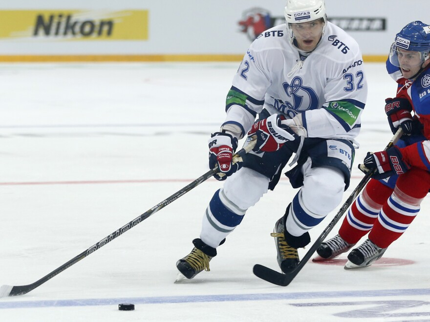 Erik Christensen, right, from Lev Praha challenges Alexander Ovechkin from Dynamo Moscow during their KHL ice hockey match in Prague, Czech Republic, Tuesday, Oct. 9. Ovechkin is among those NHL players who were signed by European clubs because of the NHL lockout.
