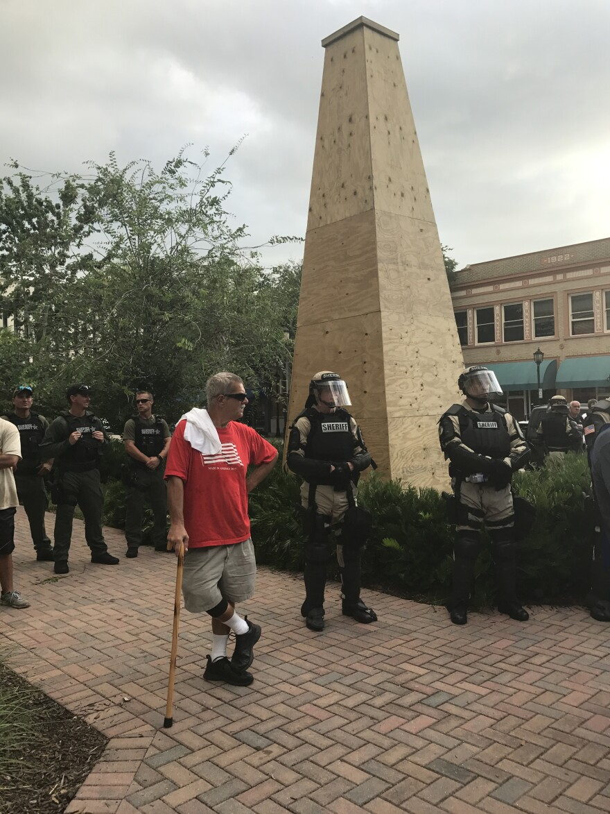Manatee Sheriff's Office deputies surrounding the Confederate monument, which was boarded up by the county ahead of the protest.