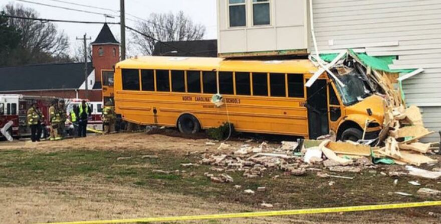 CMS school bus crashed into a condominium building off Statesville Ave. Thursday.