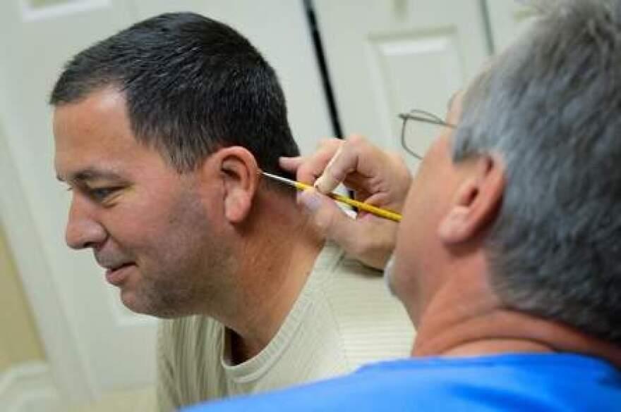 David Trainer paints James Brunelle's new ear.jpg