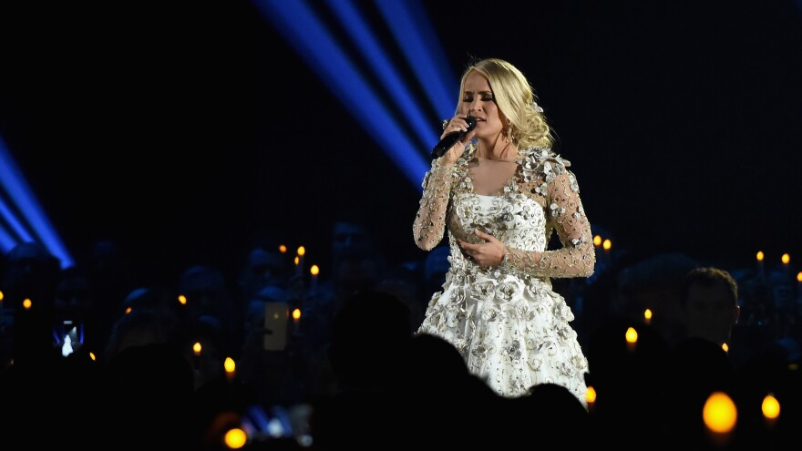 Host Carrie Underwood, who panned the CMA's decision to avoid any mention of guns during Wednesday's award show, performed a hymn as the photos of all 58 victims from Las Vegas flashed on the screen.
