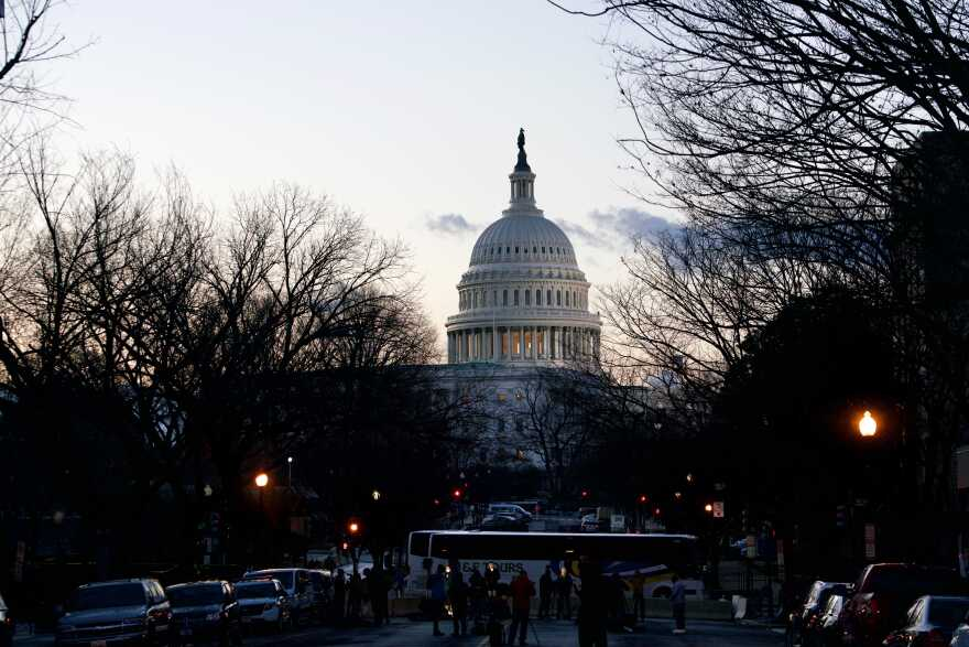 The U.S. Capitol is seen at sunrise on Wednesday, two weeks after it was stormed by a mob of pro-Trump extremists.