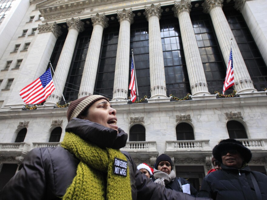 Demonstrators voiced opposition to year-end bonuses for Wall Street executives, during a protest outside the New York Stock Exchange in December 2010.