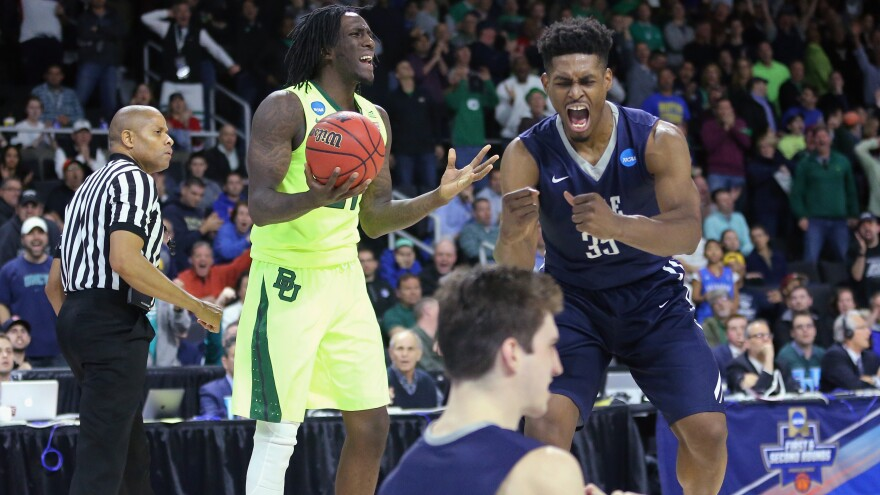 Taurean Prince (left) of the Baylor Bears explained rebounding after his team lost to Brandon Sherrod (right) of the Yale Bulldogs Thursday night, in the first round of the 2016 NCAA Men's Basketball Tournament.