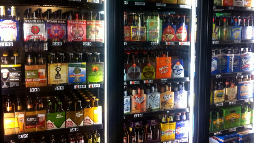 Craft brewers are reaching markets far from their home breweries. In a Washington, D.C., store, beers from California, Colorado, Louisiana, Vermont, and elsewhere are for sale.