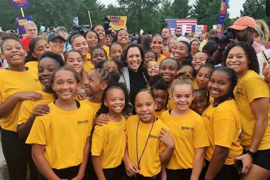 Kamala Harris poses with the Isiserettes, a legendary drill and drum team, at the Des Moines Steak Fry in 2019.