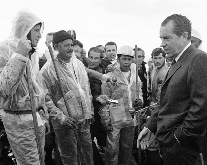 President Richard Nixon talked with workers cleaning up the oily beach at Santa Barbara in March 1969.