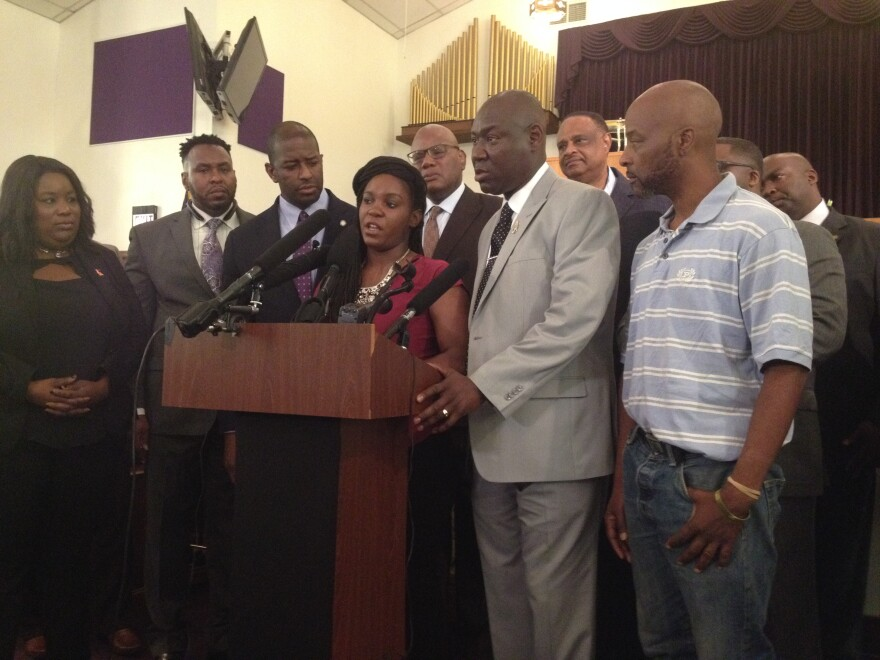 Joined by her Attorney Ben Crump and others, Brittany Jacobs speaks during a news conference inside a Tallahassee church prior to a march to the capitol Wednesday.