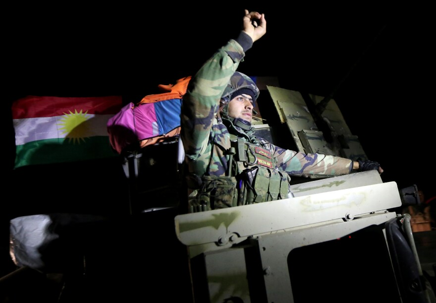 Iraqi Kurdish peshmerga fighters arrive Saturday in Sinjar in northern Iraq, where they have made gains against the Islamic State. The Kurds were talking about independence this summer, but now appear focused on fighting the Islamic State.