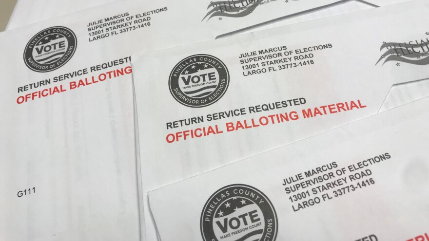 stack of mail-in ballots