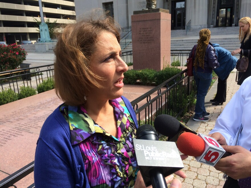 Spencer Fane attorney Jane Dueker talks to reporters after arguing against the legality of St. Louis' minimum wage law. Dueker is representing a coalition of businesses and business groups seeking to strike the law down.