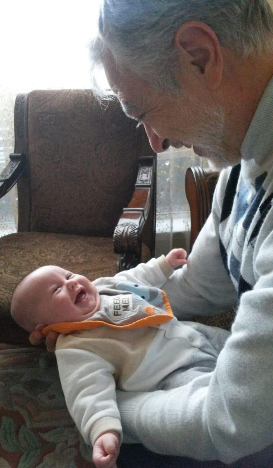 Majd Kamalmaz holds his grandchild in Texas in 2015.