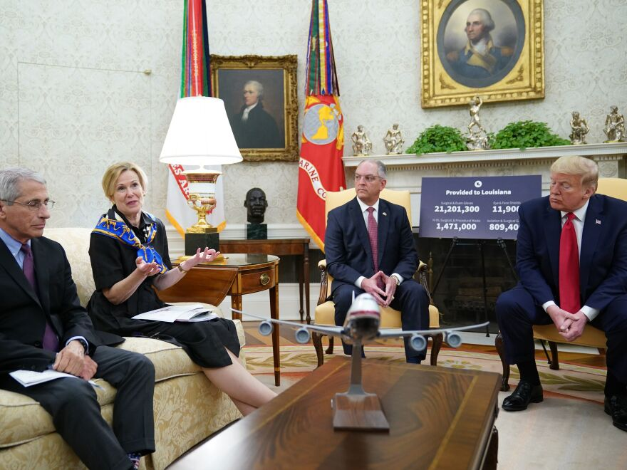 Dr. Deborah Birx, head of the White House coronavirus task force, speaks during an Oval Office meeting with Dr. Anthony Fauci (left), director of the National Institute of Allergy and Infectious Diseases; Louisiana Gov. John Bel Edwards; and President Trump on Wednesday.