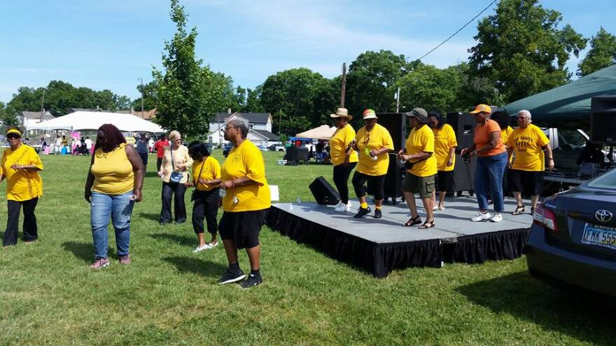 People dance onstage at last year's Juneteenth Festival.